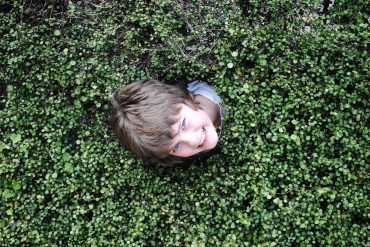Max in hedge at Heronswood